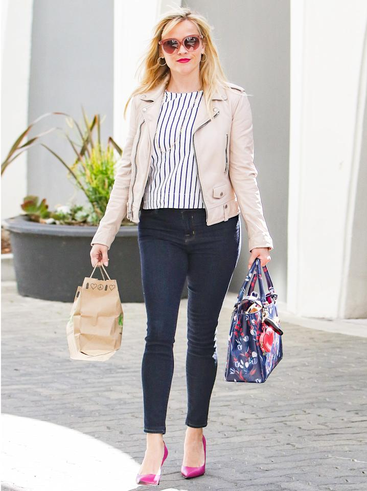 """<p>The actress stepped out to run some errands in a pair of skinny jeans, a striped top, and a pink leather jacket (try a similar style <a rel=""""nofollow"""" href=""""https://click.linksynergy.com/fs-bin/click?id=93xLBvPhAeE&subid=0&offerid=390098.1&type=10&tmpid=8157&RD_PARM1=http%253A%252F%252Fshop.nordstrom.com%252Fs%252Fandrew-marc-felicia-asymmetrical-zip-leather-jacket%252F4509598%253Forigin%253Dcategory-personalizedsort%2526fashioncolor%253DLIGHT%252520PINK&u1=ISReeseWStreetStyle3.24JA"""">here</a>) and accessorized with a Draper James tote ($245; <a rel=""""nofollow"""" href=""""http://www.pjatr.com/t/8-10718-131940-134982?sid=ISReeseWStreetStyle3.24JA&url=https%3A%2F%2Fwww.draperjames.com%2Fdunaway-vines-caroline-tote"""">draperjames.com</a>), pink sunnies, hoop earrings, and hot pink pumps.</p>"""