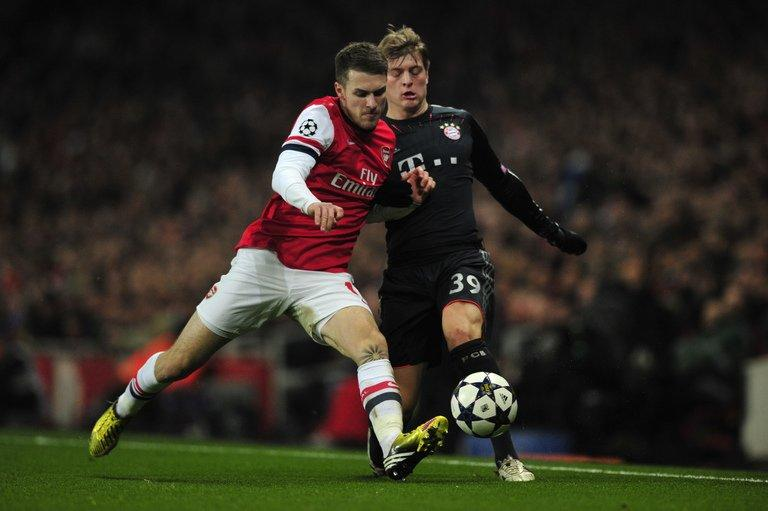 Arsenal midfielder Aaron Ramsey (left) challenges Bayern Munich's Toni Kroos in north London on February 19, 2013