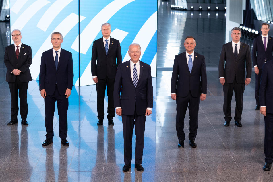 NATO Secretary General Jens Stoltenberg, second left, and U.S President Joe Biden, center, pose with other leaders during a family picture at the NATO headquarters where the 30-nation alliance hopes to reaffirm its unity and discuss increasingly tense relations with China and Russia, as the organization pulls its troops out after 18 years in Afghanistan, Monday June, 14, 2021. (Jacques Witt, Pool via AP)