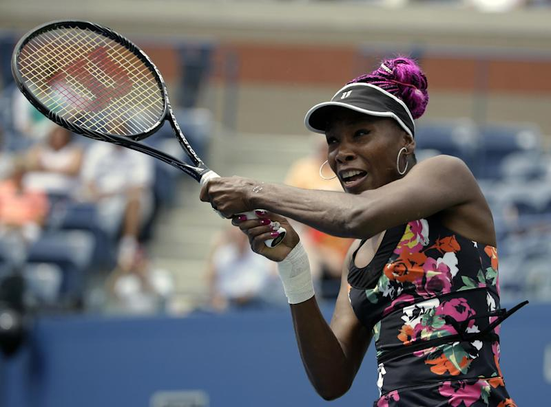 Venus Williams returns a shot to Belgium's Kirsten Flipkens during the first round of the 2013 U.S. Open tennis tournament Monday, Aug. 26, 2013, in New York. Williams defeated Flipkens. (AP Photo/David Goldman)