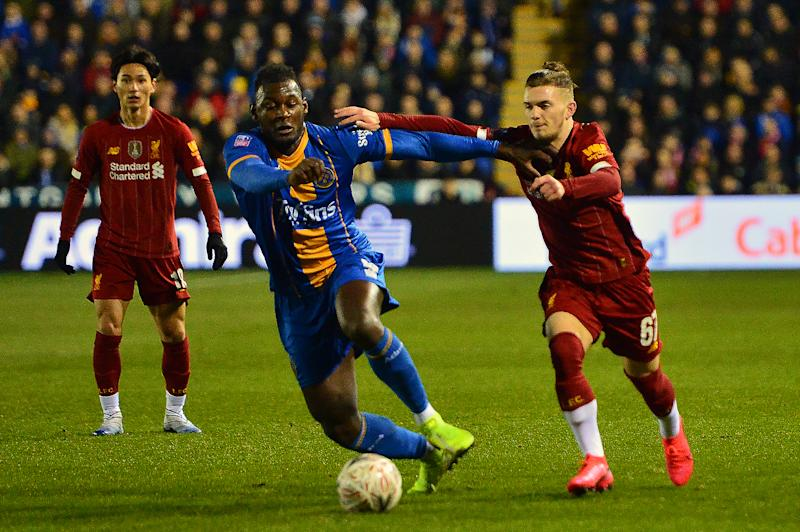 SHREWSBURY, ENGLAND - JANUARY 26: Shrewsbury Town's Aaron Pierre vies for possession with Harvey Elliott of Liverpool during the FA Cup Fourth Round match between Shrewsbury Town and Liverpool at New Meadow on January 26, 2020 in Shrewsbury, England. (Photo by Richard Martin-Roberts - CameraSport via Getty Images)