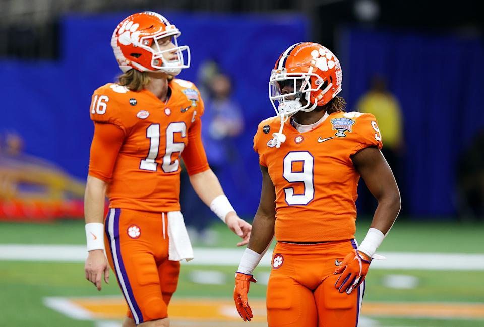 NEW ORLEANS, LOUISIANA - JANUARY 01: Trevor Lawrence #16 of the Clemson Tigers and Travis Etienne #9 of the Clemson Tigers warm up before the game against the Ohio State Buckeyes during the College Football Playoff semifinal game at the Allstate Sugar Bowl at Mercedes-Benz Superdome on January 01, 2021 in New Orleans, Louisiana. (Photo by Kevin C. Cox/Getty Images)