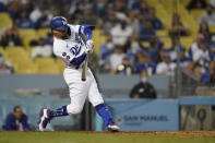 Los Angeles Dodgers' Mookie Betts doubles during the eighth inning of a baseball game against the Arizona Diamondbacks Wednesday, Sept. 15, 2021, in Los Angeles. (AP Photo/Ashley Landis)