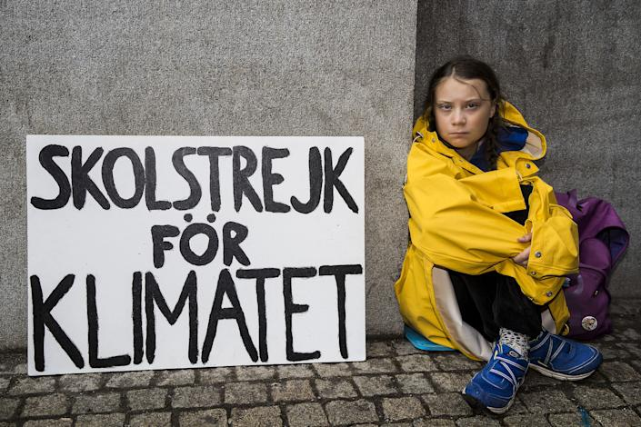 Thunberg first began skipping school in August 2018, sitting in front of Swedish Parliament to demand climate action | Michael Campanella—Getty Images