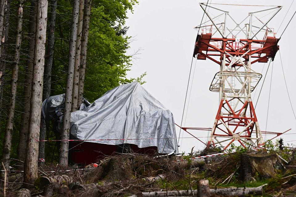 <p>The wreckage of the cable car</p> (AFP via Getty Images)