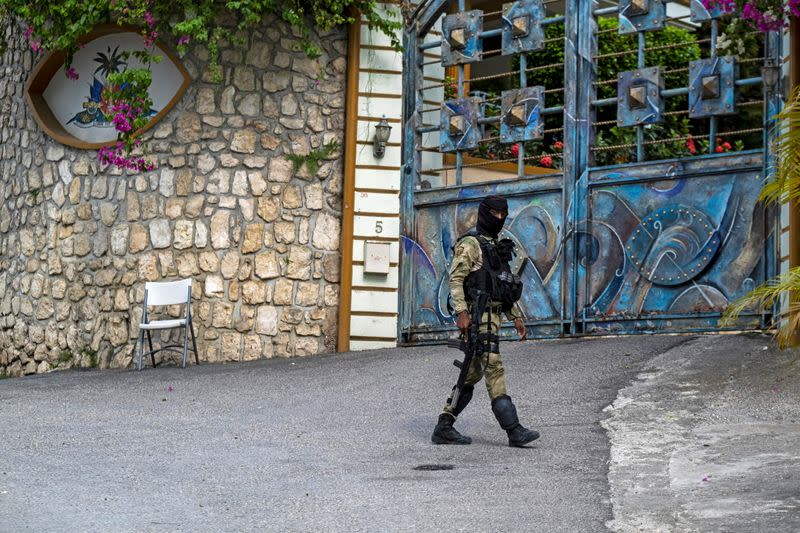 A Haitian police officer guards outside the residence of late President Moise in Port-au-Prince