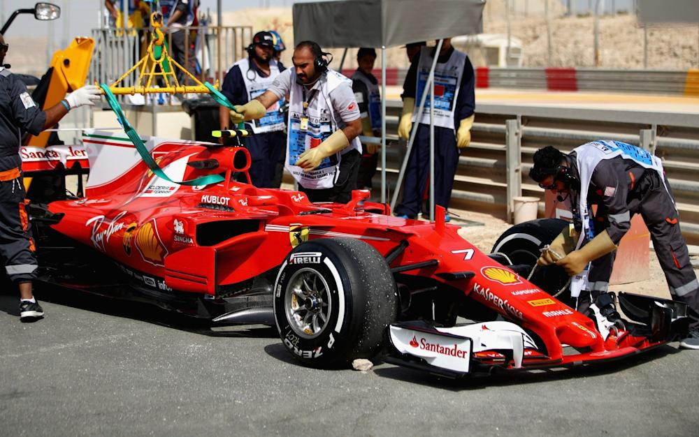 Kimi Raikkonen's Ferrari is removed from the track in Bahrain - Credit: Getty Images