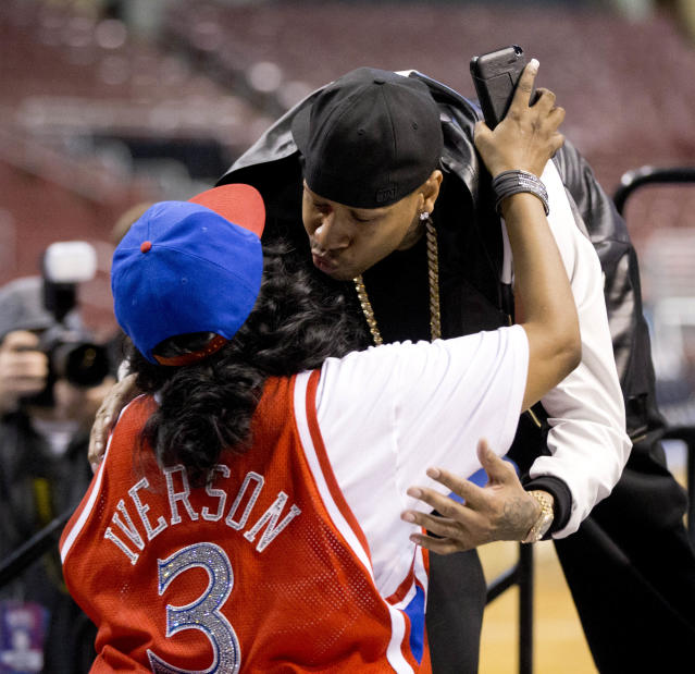 Former Philadelphia 76ers basketball player Allen Iverson greets his mother Ann Iverson as he arrives for a news conference Wednesday, Oct. 30, 2013, in Philadelphia. Iverson officially retired from thne NBA, ending a 15-year career during which he won the 2001 MVP award and four scoring titles. Iverson retired in Philadelphia where he had his greatest successes and led the franchise to the 2001 NBA finals. (AP Photo/Matt Rourke)