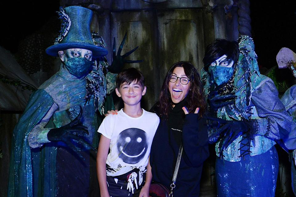 <p>staying brave with son William at Knott's Scary Farm in Buena Park, California, on Sept. 25.</p>
