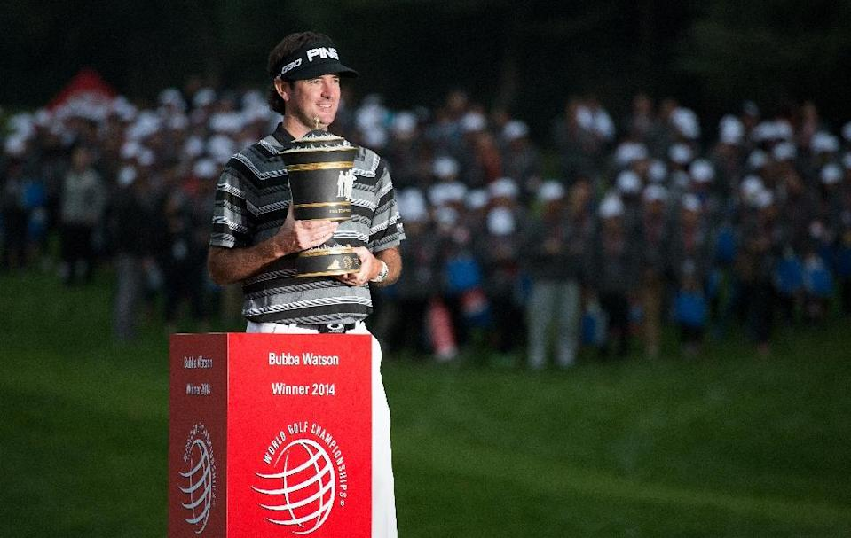 Bubba Watson poses with his trophy after winning the WGC-HSBC Champions Golf tournament in Shanghai on November 9, 2014 (AFP Photo/Johannes Eisele)
