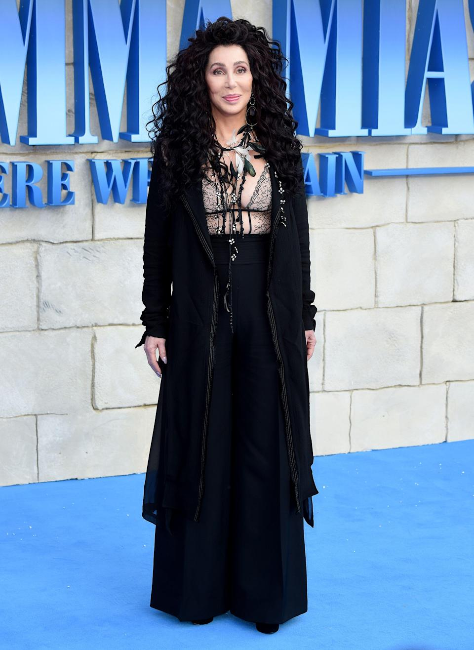 <p>On 16 July, Cher wore an all-black get-up for the UK premiere of 'Mamma Mia! Here We Go Again'. <em>[Photo: Getty]</em> </p>