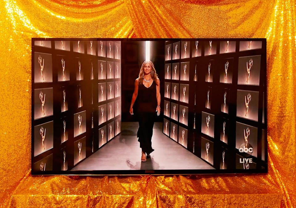 """<h2>Jennifer Aniston in Vintage Dior<br></h2><br>Jennifer Aniston has always been minimal in the fashion department, be it in the form of a varsity T-shirt and a midi skirt on <em>Friends</em> or a white satin dress at the 2019 Emmys. So why would this year be any different? To verbally spar with host Jimmy Kimmel, <em>The Morning Show</em> actress appeared """"on-stage"""" wearing the simplest of black slip dresses, which she paired with lots and lots of diamonds. <span class=""""copyright"""">Photographed by Joel Arbaje for Refinery29.</span>"""