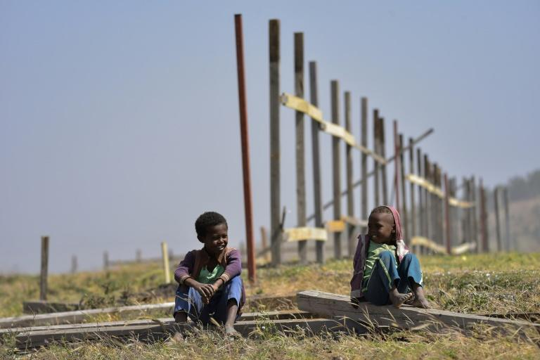 A year later, the crash site of Ethiopian Airlines Flight 302 is surrounded by an unfinished wooden fence