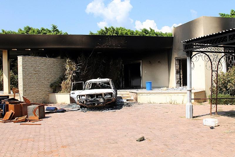 File picture shows a burnt house and a car inside the US Embassy compound in September, 2012 in Benghazi, Libya following an attack which left the US ambassador to Libya and three of his colleagues dead (AFP Photo/)