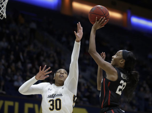 Stanford's Kiana Williams, right, shoots against California's CJ West (30) in the first half of an NCAA college basketball game Sunday, Jan. 12, 2020, in Berkeley, Calif. (AP Photo/Ben Margot)