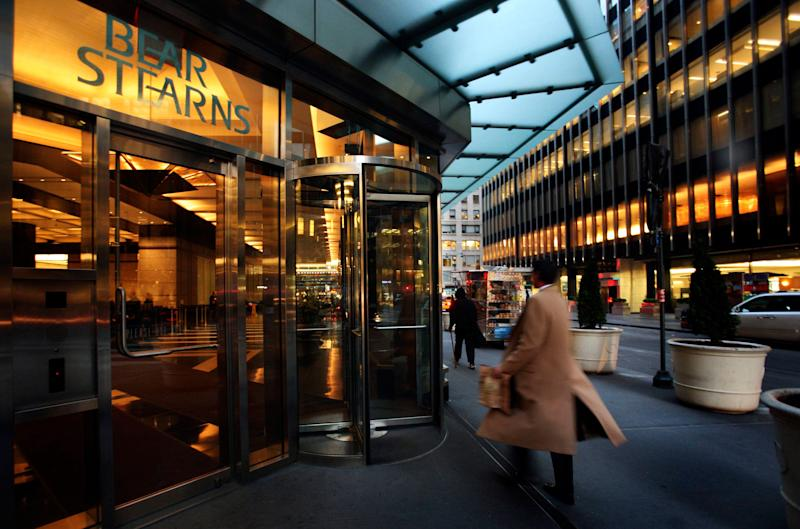 FILE - In this Monday, March 17, 2008, file photo, an employee enters Bear Stearns in New York. While JP Morgan didn't buy Bear Stearns until 2008, in 2013, it is contesting the attorney general's lawsuit, which targets investments sold by the company in 2006 and 2007. (AP Photo/Mark Lennihan, File)