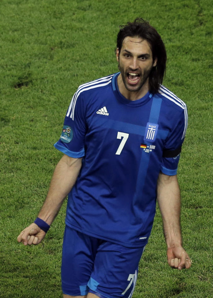Greece's Giorgos Samaras celebrates scoring his side's first goal during the Euro 2012 soccer championship quarterfinal match between Germany and Greece in Gdansk, Poland, Friday, June 22, 2012. (AP Photo/Gero Breloer)