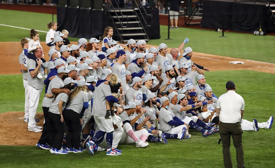 Oct 18, 2020; Arlington, Texas, USA; The Los Angeles Dodgers celebrate and pose for a photo after defeating the Atlanta Braves in game seven of the 2020 NLCS at Globe Life Field. Mandatory Credit: Kevin Jairaj-USA TODAY Sports