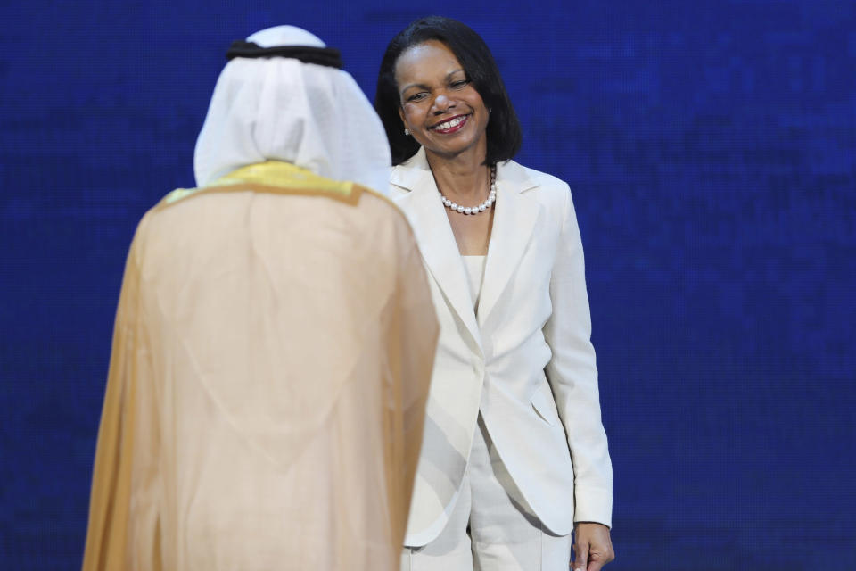 FILE - In this Nov. 11, 2019 file photo, former U.S. Secretary of State Condoleezza Rice shakes hands with UAE Energy Minister Suhail al-Mazrouei at the opening ceremony of the Abu Dhabi International Petroleum Exhibition & Conference (ADIPEC) in Abu Dhabi, United Arab Emirates. Rice succeeded Colin Powell as secretary of state and has since returned to Stanford University as provost, then as a faculty member. In 2012, she also became one of the first two women allowed to join the Augusta National Golf Club. (AP Photo/Kamran Jebreili, File)