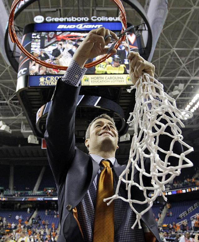 Virginia head coach Tony Bennett cuts down the net after defeating Duke in an NCAA college basketball game in the championship of the Atlantic Coast Conference tournament in Greensboro, N.C., Sunday, March 16, 2014. Virginia won 72-63. (AP Photo/Bob Leverone)