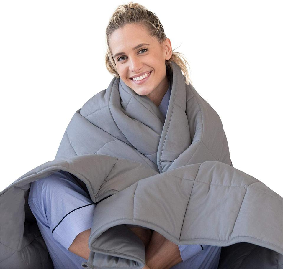 """<p>You're not going to want to share this <a href=""""https://www.popsugar.com/buy/Luna-Adult-Weighted-Blanket-557397?p_name=Luna%20Adult%20Weighted%20Blanket&retailer=amazon.com&pid=557397&price=50&evar1=fit%3Aus&evar9=47315539&evar98=https%3A%2F%2Fwww.popsugar.com%2Ffitness%2Fphoto-gallery%2F47315539%2Fimage%2F47315544%2FLuna-Adult-Weighted-Blanket&list1=shopping%2Camazon%2Cstress%20relief%2Canxiety%2Chealthy%20living&prop13=mobile&pdata=1"""" class=""""link rapid-noclick-resp"""" rel=""""nofollow noopener"""" target=""""_blank"""" data-ylk=""""slk:Luna Adult Weighted Blanket"""">Luna Adult Weighted Blanket</a> ($50, originally $57).</p>"""