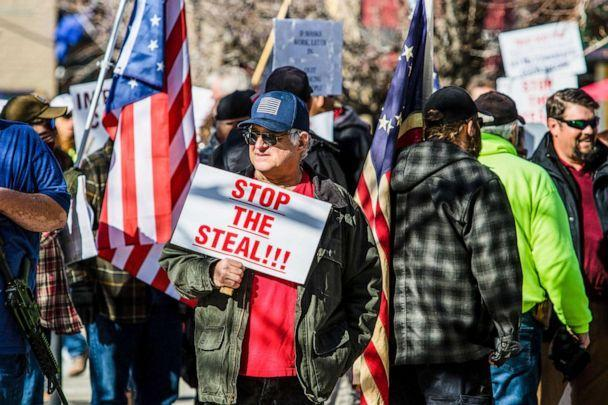 PHOTO: A protestor holds a placard reading, 'stop the steal,' during a demonstration at Nevada's state legislative building in Carson, Nev., Feb 1, 2021. (Ty O'Neil/SOPA Images/Shutterstock)