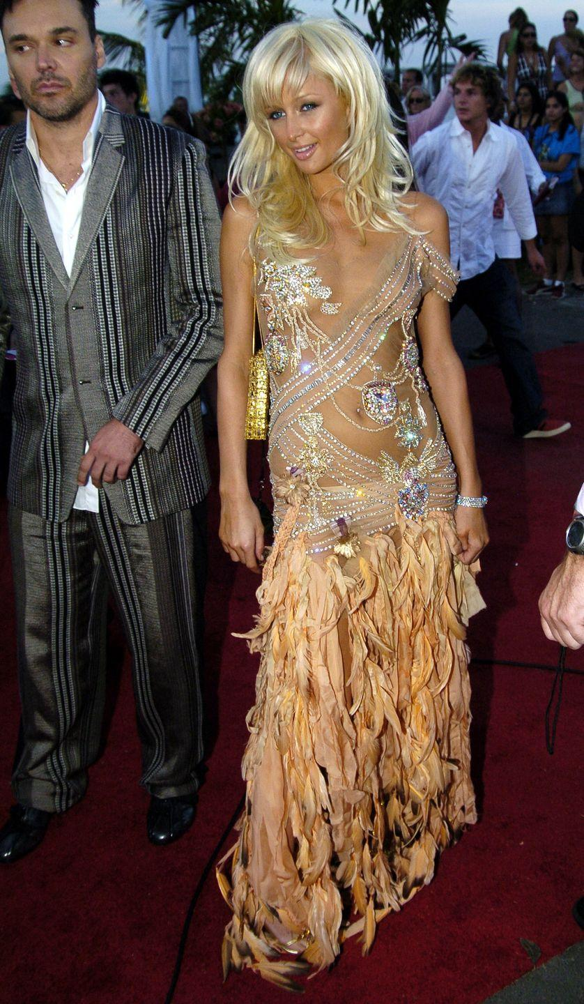<p>Paris Hilton had nothing to hide in this completely sheer embellished dress in 2004.</p>