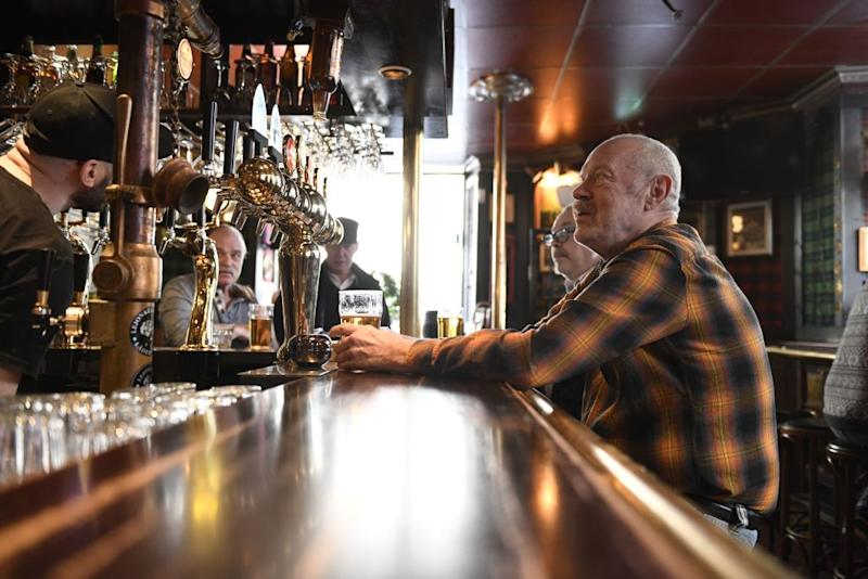 A man sits at a bar in Sweden.