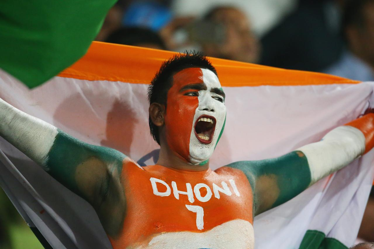DHAKA, BANGLADESH - MARCH 23:  An Indian fan shows his support in the crowd during the ICC World Twenty20 Bangladesh 2014 match between West Indies and India at Sher-e-Bangla Mirpur Stadium on March 23, 2014 in Dhaka, Bangladesh.  (Photo by Scott Barbour/Getty Images)