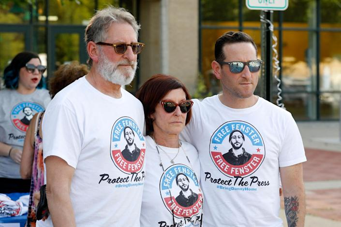 Image: The parents of detained journalist Danny Fenster, from left, Buddy Fenster and Rose Fenster and brother Bryan Fenster in Huntington Woods, Mich., on June 4, 2021. (Jeff Kowalsky / AFP - Getty Images)