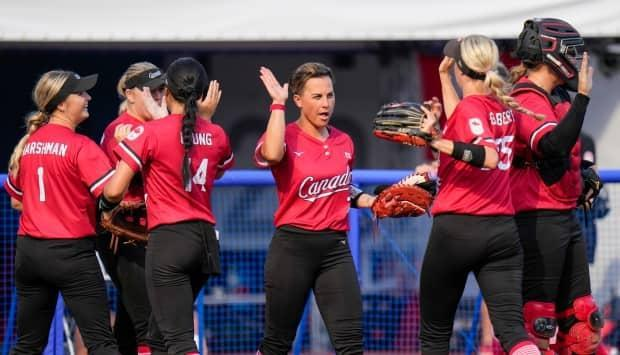 Canadian players celebrate during the softball game in Fukushima, Japan, against Mexico as competition got underway on Wednesday.  (Jae C. Hong/The Associated Press - image credit)