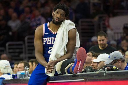 Apr 15, 2019; Philadelphia, PA, USA; Philadelphia 76ers center Joel Embiid (21) rest on the scorers table during the second quarter in game two of the first round of the 2019 NBA Playoffs against the Brooklyn Nets at Wells Fargo Center. Mandatory Credit: Bill Streicher-USA TODAY Sports