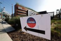 "An Uber logo and a ""I voted"" sign are seen in Redondo Beach, Los Angeles"