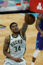 Milwaukee Bucks forward Giannis Antetokounmpo dunks against the Charlotte Hornets during the second half of an NBA basketball game on Tuesday, April 27, 2021, in Charlotte, N.C. (AP Photo/Chris Carlson)