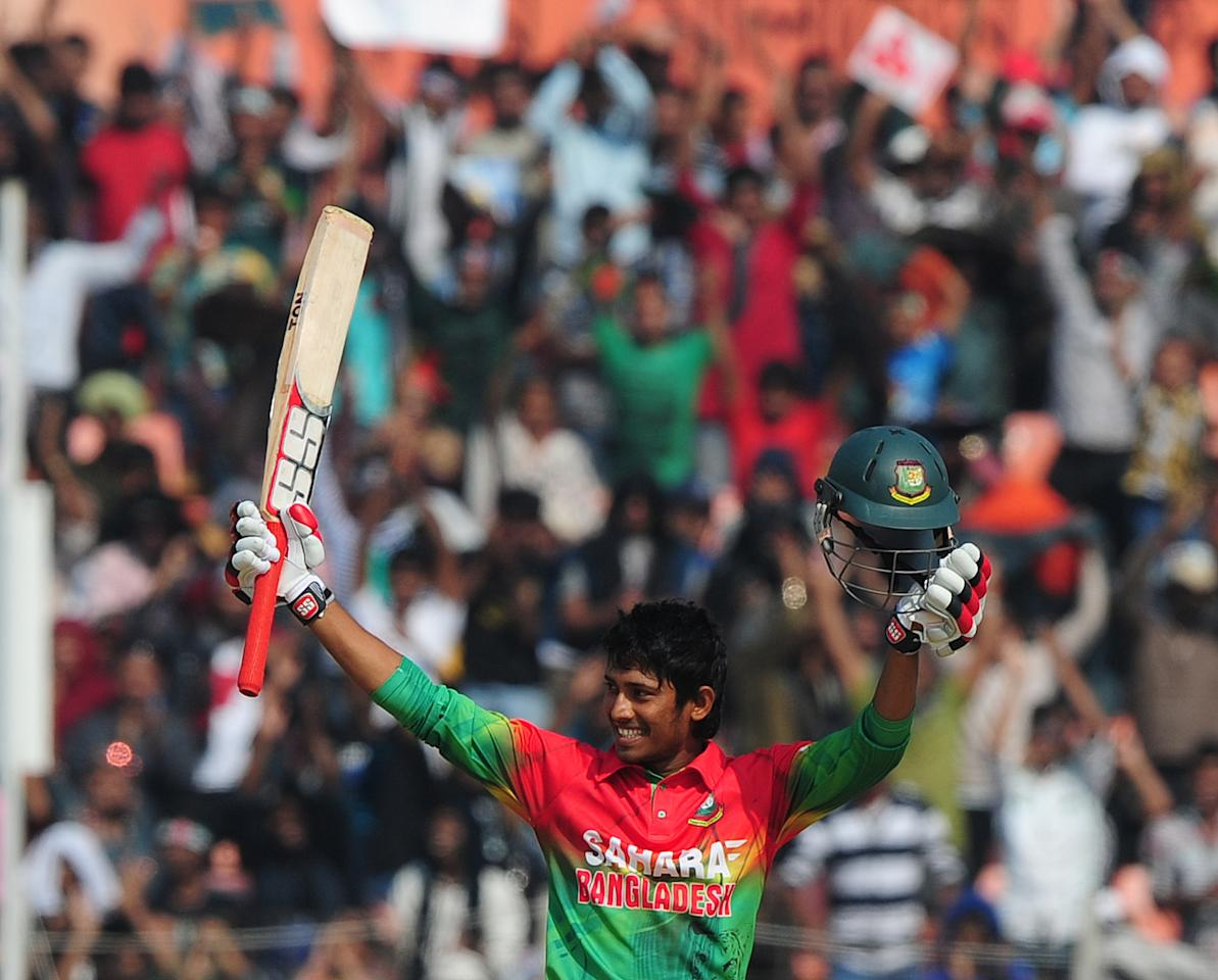 Bangladesh cricketer Anamul Haque reacts after scoring a century (100 runs) during the second one day international cricket match between Bangladesh and the West Indies at the Sheikh Abu Naser Stadium in Khulna on December 2, 2012. AFP PHOTO/ Munir uz ZAMAN