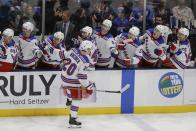 New York Rangers' Chris Kreider (20) celebrates with teammates after scoring a goal during the third period of an NHL hockey game against the New York Islanders Thursday, Jan. 16, 2020, in Uniondale, N.Y. The Rangers won 3-2. (AP Photo/Frank Franklin II)