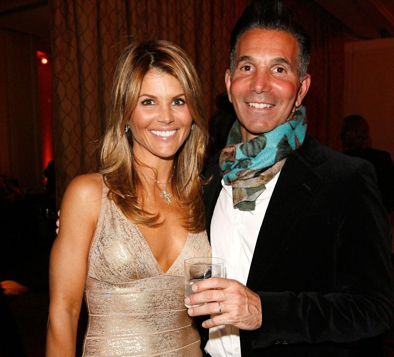 Actress Lori Loughlin (L) and husband Mossimo Giannulli attend the Saks Fifth Avenue's Unforgettable Evening cocktail reception benefiting Entertainment Industry Foundation's (EIF) Women's Cancer Research Fund held at the Beverly Wishire Hotel on February 20, 2008 in Beverly Hills, California. (PhotoDonato Sardella/WireImage/Getty Images)