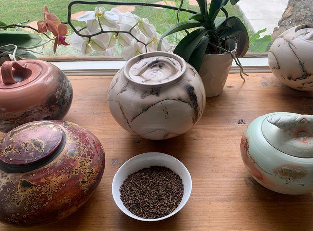 The white bowl in the foreground contains the composted remains of a pig, whose body was broken down using natural organic reduction. Human composted remains would have similar properties. (Photo: Dominique Mosbergen)