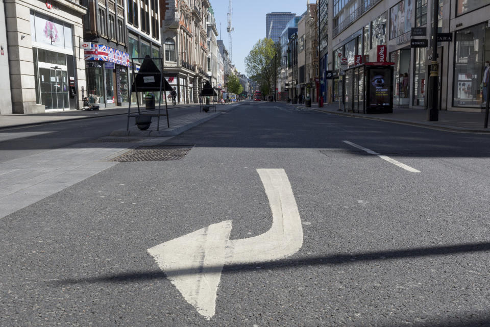 At the beginning of the fourth week of the UK government's lockdown during the Coronavirus pandemic, and with 120,067 UK reported cases with 16,060 deaths, a traffic arrow points right on Oxford Street that would normally be a busy thoroughfare for shoppers and traffic and which remains largely deserted at mid-day, on 20th April 2020, in London, England. (Photo by Richard Baker / In Pictures via Getty Images)