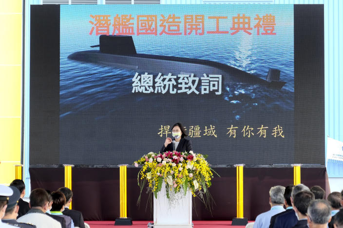 """Taiwan's President Tsai Ing-wen speaks during a ceremony to inaugurate the production of domestically-made submarines at CSBC Corp's shipyards in the southern city of Kaohsiung, Taiwan on Tuesday, Nov. 24, 2020. The move marks a step forward for the island's defense strategy at a time of elevated tensions with China. Words in the back reads """"Domestic submarine inauguration ceremony"""", """"President Speech"""" and """"Defending our territory involves all"""" (AP Photo/Huizhong Wu)"""