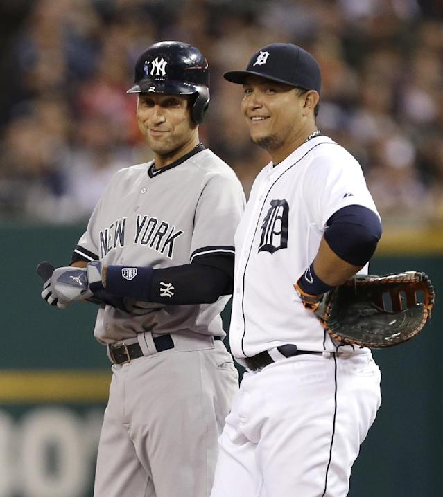 New York Yankees' Derek Jeter, left, laughs with Detroit Tigers first baseman Miguel Cabrera after hitting a single in the first inning of a baseball game in Detroit Tuesday, Aug. 26, 2014. (AP Photo/Paul Sancya)