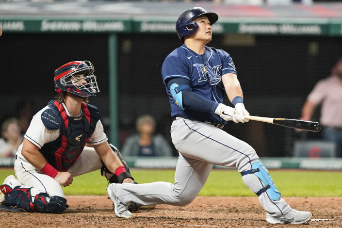 Tampa Bay Rays' Ji-Man Choi watches his three-run home run next to Cleveland Indians catcher Austin Hedges in the ninth inning of a baseball game Friday, July 23, 2021, in Cleveland. (AP Photo/Tony Dejak)