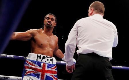 FILE PHOTO: Boxing - Tony Bellew vs David Haye - O2 Arena, London, Britain - May 5, 2018 David Haye receives a count from the referee after being knocked down by Tony Bellew Action Images via Reuters/Andrew Couldridge/File Photo