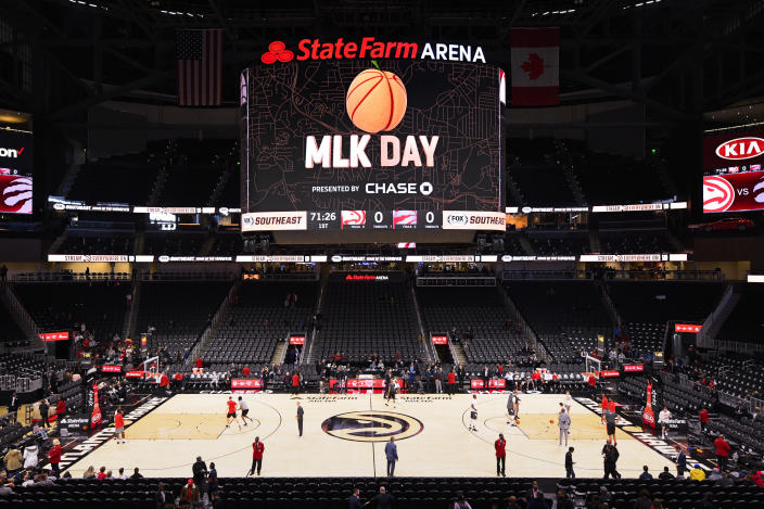 Players with the Atlanta Hawks and the Toronto Raptors warm up before an annual Dr. Martin Luther King Jr. Day afternoon NBA basketball game, Monday, Jan. 20, 2020, in Atlanta. (AP Photo/John Amis)