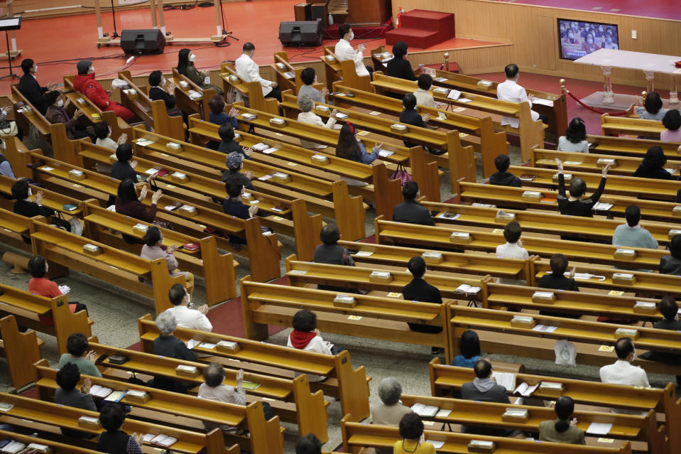Christians wearing face masks as a precaution against the coronavirus attend while maintaining social distancing during an Easter service at the Yoido Full Gospel Church in Seoul, South Korea, Sunday, April 4, 2021. The church allowed only 20 percent members of the capacity to attend at the Easter service as a part of measure to prevent against the coronavirus. (AP Photo/Lee Jin-man)