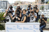 FILE - In this July 6, 2021 file photo Marion Cotillard poses for photographers at the photo call for the film Annette at the 74th international film festival, Cannes, southern France. (Photo by Vianney Le Caer/Invision/AP, File)