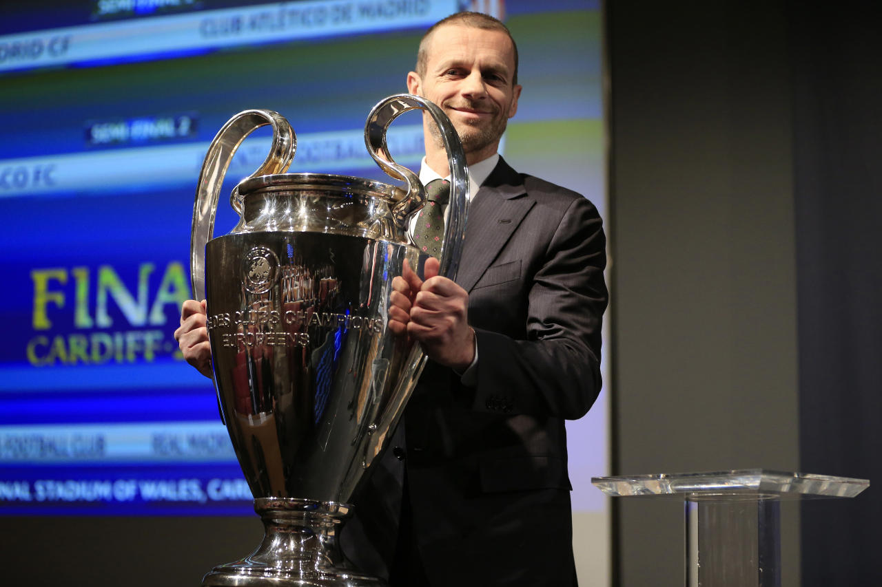 Football Soccer - UEFA Champions League Semi-Final Draw - Nyon, Switzerland - 21/4/17 UEFA President Aleksander Ceferin poses with the UEFA Champions League trophy before the draw of the semi-finals Reuters / Pierre Albouy Livepic
