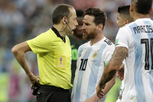 Argentina's Lionel Messi, center, complains to the referee Cuneyt Cakir during the group D match between Argentina and Nigeria, at the 2018 soccer World Cup in the St. Petersburg Stadium in St. Petersburg, Russia, Tuesday, June 26, 2018. (AP Photo/Petr David Josek)