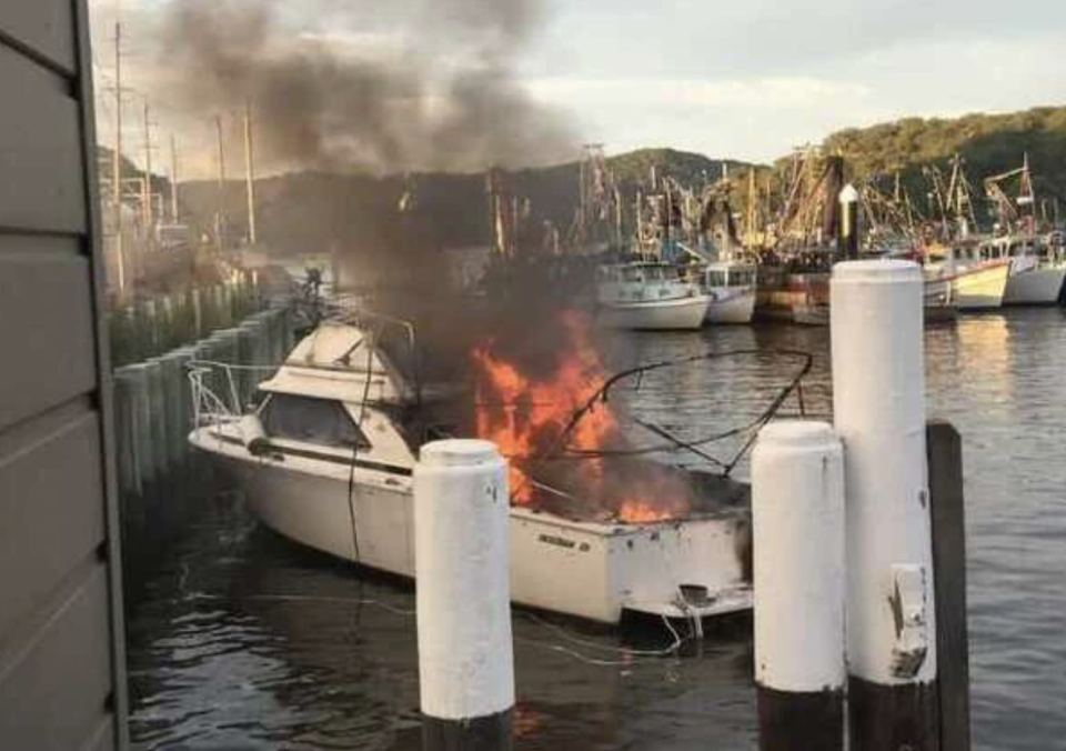 A boat on fire after an explosion on the Hawkesbury River.