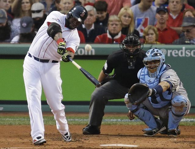 Boston Red Sox's David Ortiz hits a solo home run off Tampa Bay Rays starting pitcher David Price in front of Rays catcher Jose Molina during the first inning in Game 2 of baseball's American League division series, Saturday, Oct. 5, 2013, in Boston. (AP Photo/Stephan Savoia)